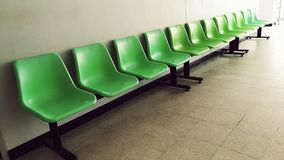 Green chair. Comehere and sitdown stock photo