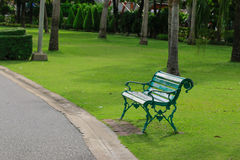 Green chair in the garden Royalty Free Stock Photo