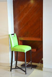 Green chair at lounge area in the hotel. Stock Image