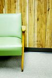 Green chair panel wall Stock Photography
