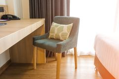 Green chair with pillow in Modern Bedroom.  stock photos