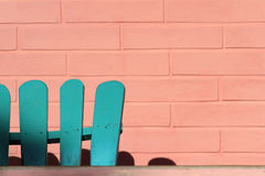 Green chair and pink wall Royalty Free Stock Image