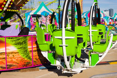 Green Chair Ride in a an Amusement Park Stock Photography