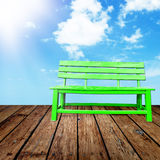 Green chair and wooden floor Stock Photography