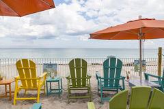 Green chairs and blue summer beach house. Stock Image