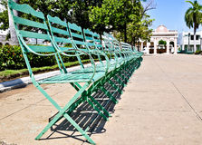Green chairs in public garden Royalty Free Stock Photo