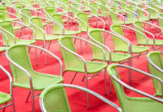 Green chairs rows. On red carpet Stock Image