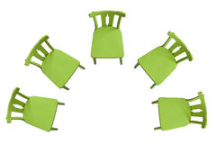 Green chairs standing on a white background in a semicircle Royalty Free Stock Images