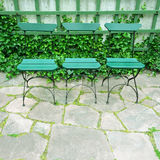 Green chairs in summer garden Stock Image
