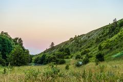 Green chalk hills in evening time Stock Photos