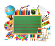 Green chalkboard. With school supplies Stock Photos