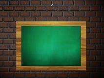Green chalkboard hang on brick wall Stock Image