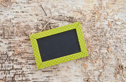 Green chalkboard on rustic wood Royalty Free Stock Photo