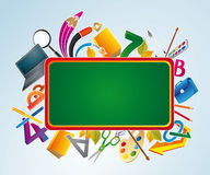 Green chalkboard with school supplies. Royalty Free Stock Images
