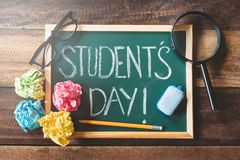 Free Green Chalkboard With Handwritten STUDENT`S DAY Word On Wooden Table Stock Image - 160821561