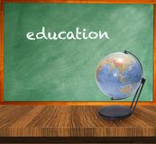 A green chalkboard wooden table. Education concept Stock Photo