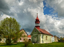 The Green chapel. Chapel in the middle of the village in May afternoon Royalty Free Stock Photos