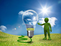 Green character showing a light bulb Stock Photos
