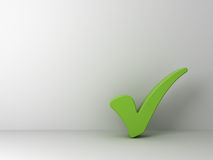 Green check mark on empty white wall Royalty Free Stock Photography
