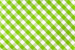 Green checked fabric tablecloth. Green checked fabric gingham tablecloth Royalty Free Stock Images