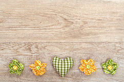 Heart and flowers on a wooden board Royalty Free Stock Photography