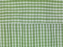 Green checkered background. Close up Stock Images