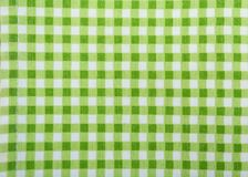 Green checkered cloth as background. Closeup Royalty Free Stock Images