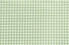 Green checkered fabric tablecloth Stock Images