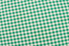 Green checkered fabric. Green and white checkered fabric, traditional picnic tablecloth Royalty Free Stock Photo