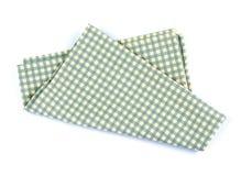 Green checkered napkin table clothes  on white background. A green checkered napkin table clothes  on white background Royalty Free Stock Images