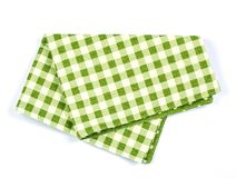 Green checkered napkin table clothes on white background. royalty free stock photography