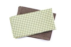 Green checkered napkin table clothes on white background. royalty free stock photos