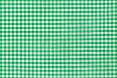 Green checkered picnic tablecloth. Stock Photos