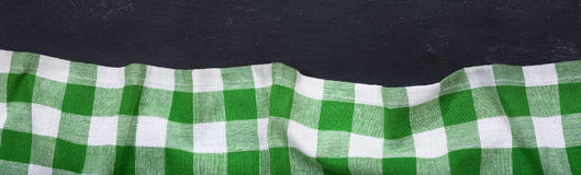 Green checkered tablecloth on dark table. Top view with copy space, banner Royalty Free Stock Images