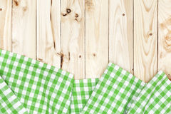 Green checkered tablecloth on wooden table, top view Royalty Free Stock Photography