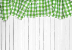 Green checkered tablecloth on wooden table, top view Royalty Free Stock Photo