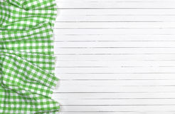 Green checkered tablecloth on wooden table, top view Royalty Free Stock Image
