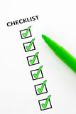 Green checklist. Checklist of completed tasks, with green felt pen Royalty Free Stock Photo