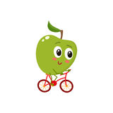 Green cheerful smiling apple riding a bicycle Stock Image