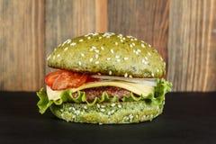Green cheeseburger close-up Royalty Free Stock Photo