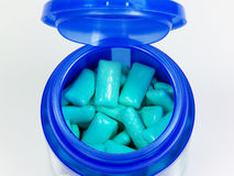 Green Chewing gums. In blue plastic bottle royalty free stock image