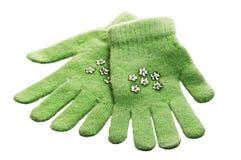 Green children's gloves Stock Images