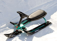 Green Children's sled (snowmobile, snowbicycle). The photo was taken near Moscow Stock Photos