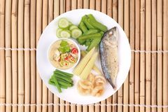 Green chili dip as Nam Prik Num with set. Isolated of Ready Thai food served, Green chili dip as Nam Prik Num in Thai with deep firedmackerel,crispy pork rind stock photos