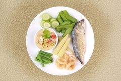 Green chili dip as Nam Prik Num with set. Isolated of Ready Thai food served, Green chili dip as Nam Prik Num in Thai with deep firedmackerel,crispy pork rind royalty free stock photos