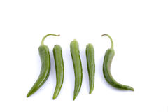 Green chili peppers. Some green chili peppers placed on a white background stock photos