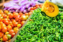 Chili peppers. Green chili peppers at market Stock Photography