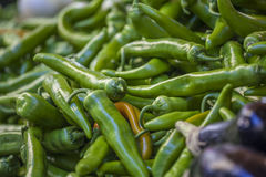 Green chili peppers on sale at the market Stock Photo