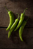 Green chili  on wood background Stock Images