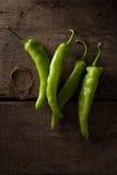 Green chili  on wood background Royalty Free Stock Image